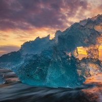 Blue iceberg at sunrise