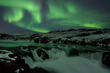 Cascades under the Aurora Light