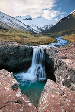 Waterfall in a remote valley in Southern Iceland