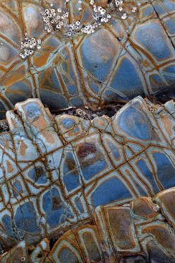 Stone patterns on the beach along the California Coast