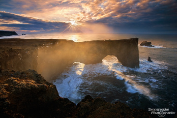 Dyrholaey Arch at sunrise in Iceland